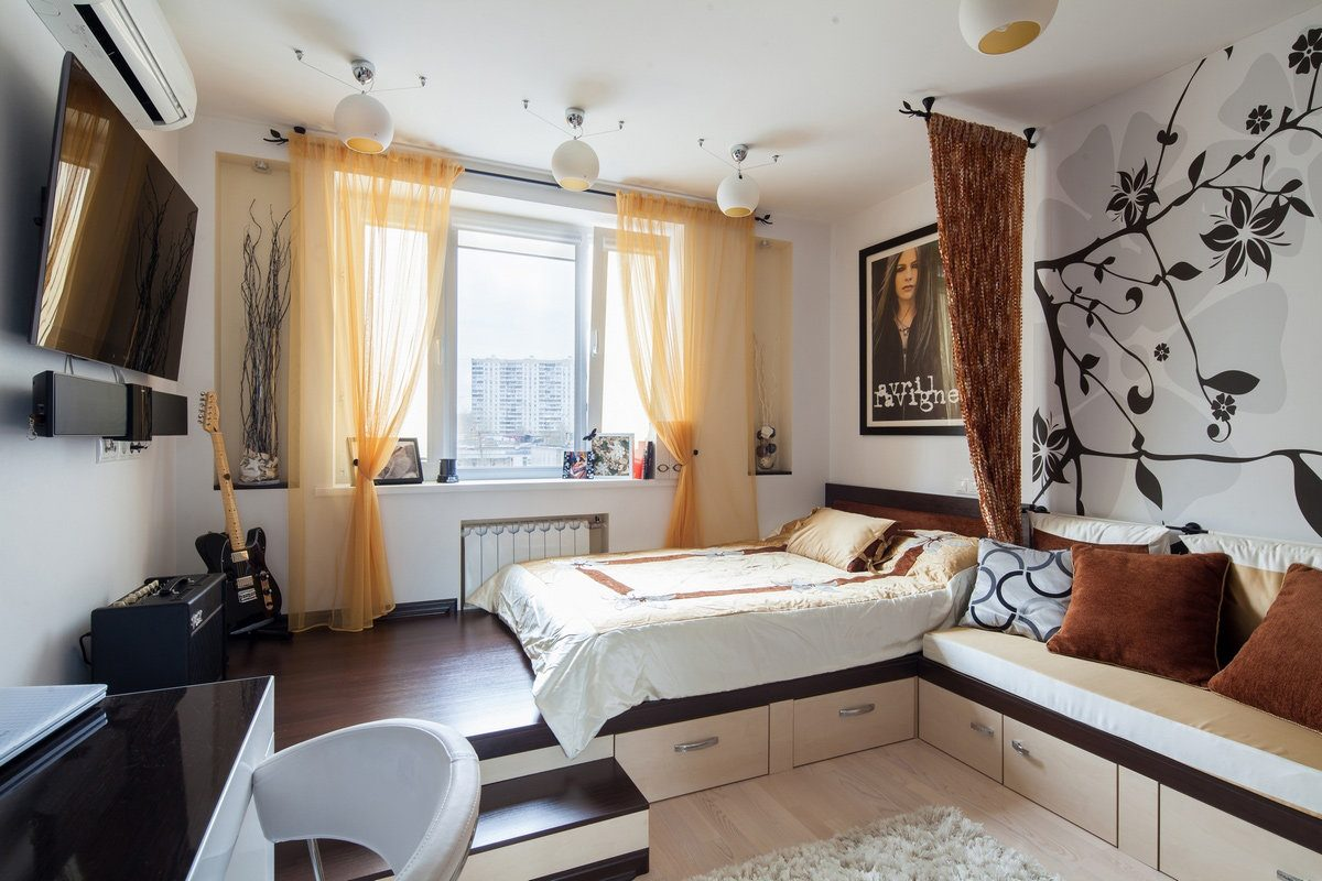 Yellow drapes and restrained design for the bedroom with the bed with drawers