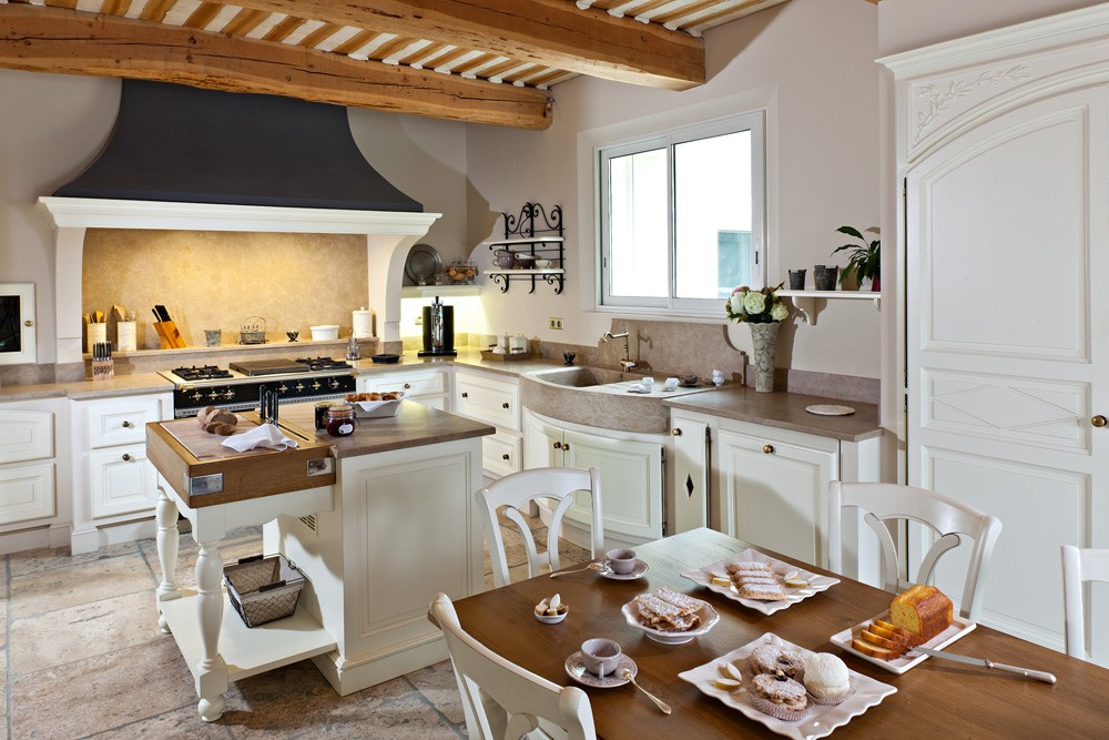 Nice richly decorated rustic style kitchen with dark extractor hood
