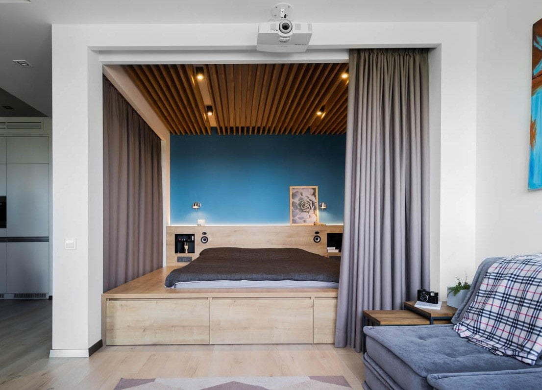 Unusual coloreful decoration of the bed zone
