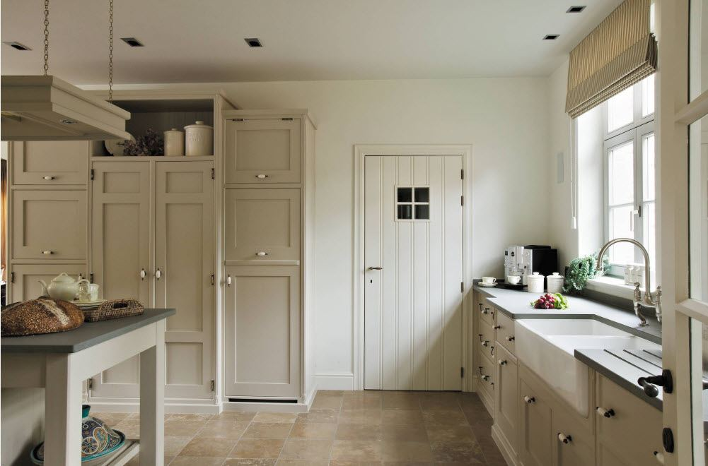 Simple designed white pastel color painted kitchen interior