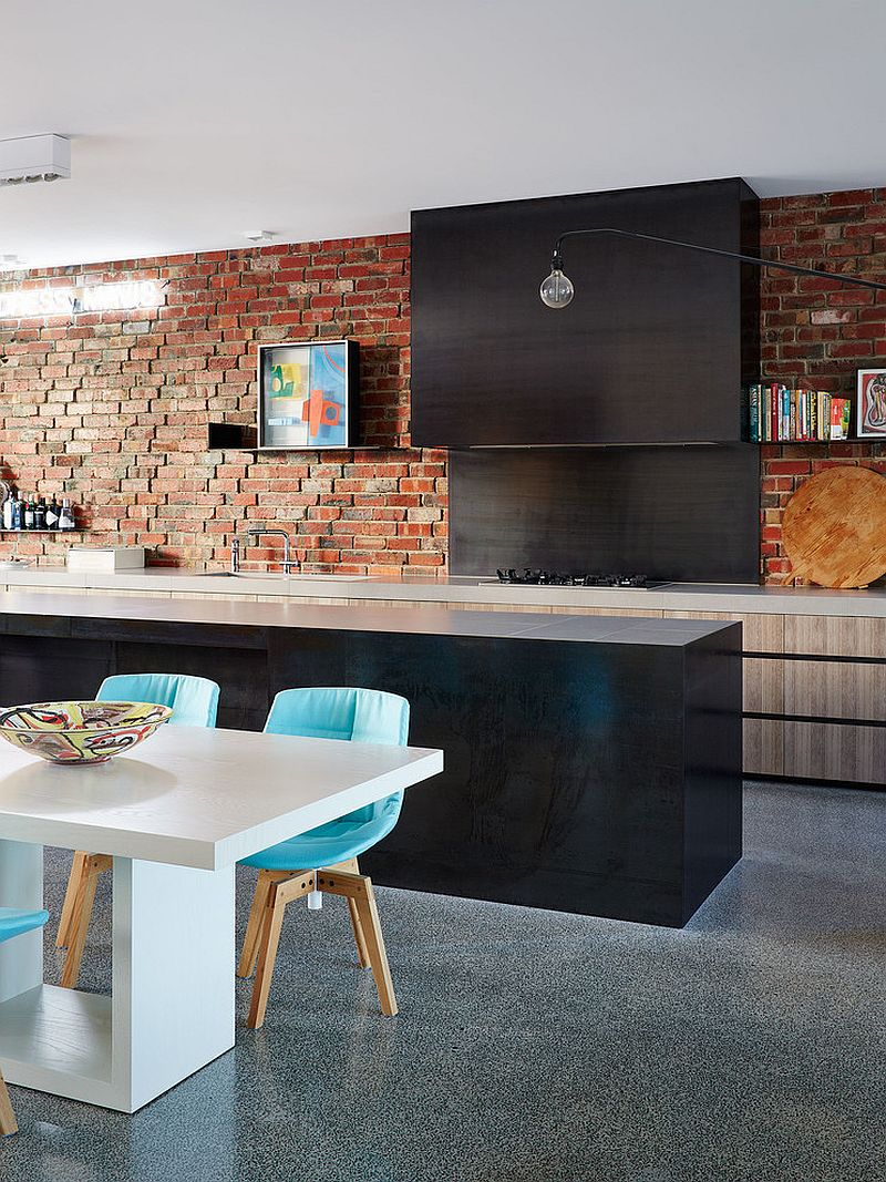 Exposed brickrowk, dark zones at the wall and central island for classy fusion kitchen