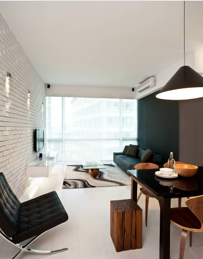 Stunning ultramodern minimalistic designed living room with whitewashed wall and black accent opposite wall