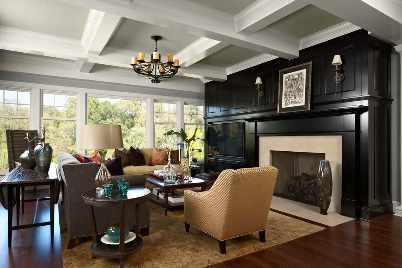 White coffered ceiling for spacious Classic designed room with beige furniture and black accent wall