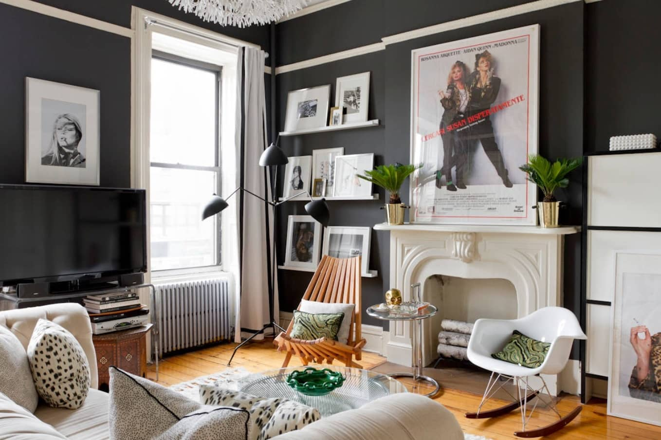 Breaking Stereotypes with Black Accent Wall Living Room Decoration. Vintage shabby chic designed room with artificial fireplace and picture decoration