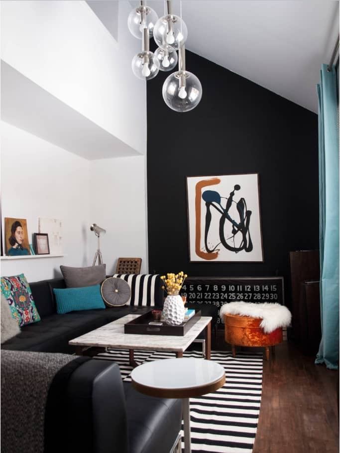 Breaking Stereotypes with Black Accent Wall Living Room Decoration. Dark impressionistic picture, zebra rug and soft furniture
