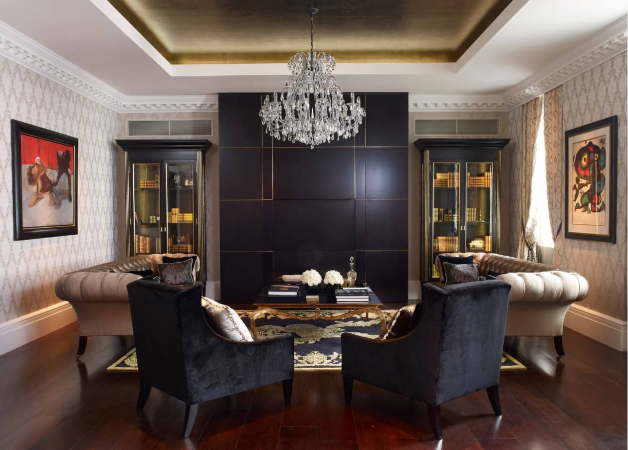 Breaking Stereotypes with Black Accent Wall Living Room Decoration. Classic room with hvac system, crystal chandelier and panels on the accent wall