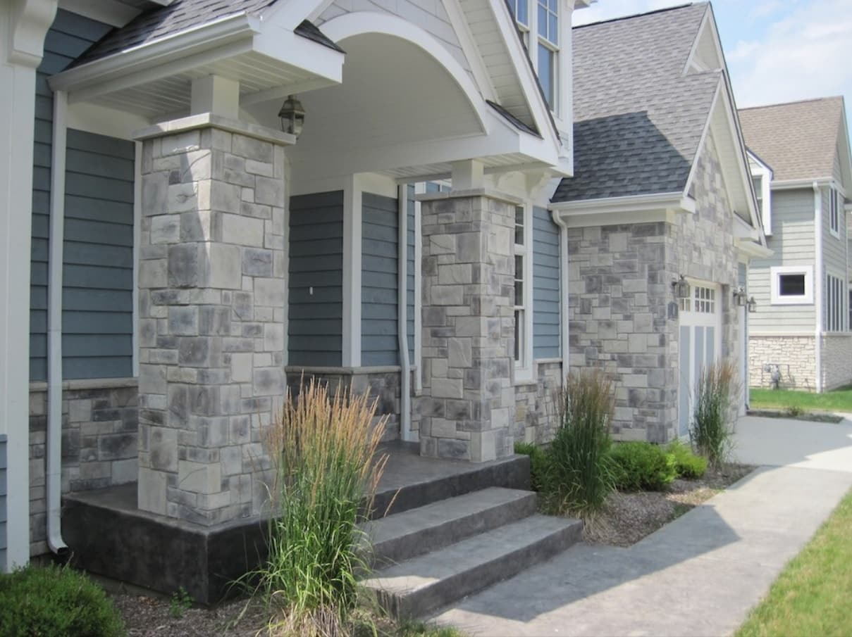 The Different Types of House Siding: How They Compare and Contrast. Stone trimmed exterior of large mansion