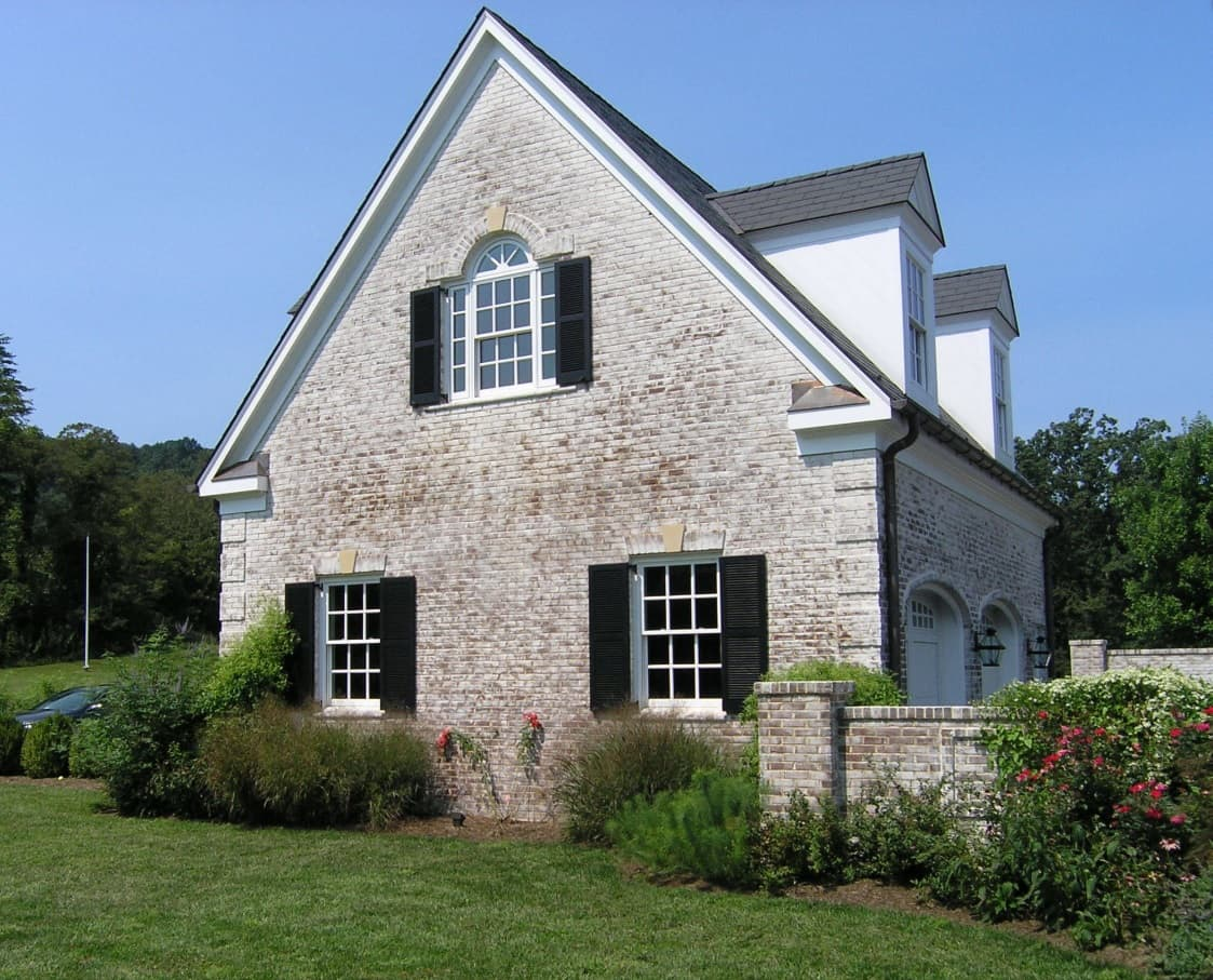 The Different Types of House Siding: How They Compare and Contrast. Whitewashed brick for English styled house facade
