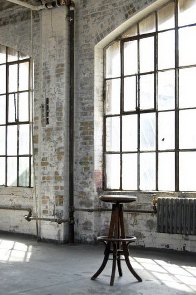 Bold, Unexpected, Mind-changing Industrial Studio Apartment Design. Whitewashed walls in the former warehouse with minimum of furniture