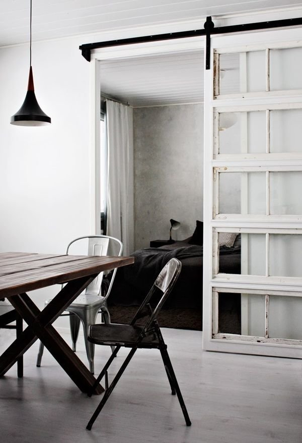 Bold, Unexpected, Mind-changing Industrial Studio Apartment Design. Dark wooden furniture and white walls, sash silding door