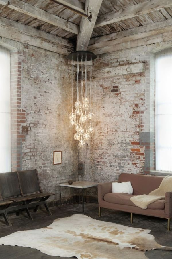 Bold, Unexpected, Mind-changing Industrial Studio Apartment Design. Bunch of lamps on cords to enlight austere living area