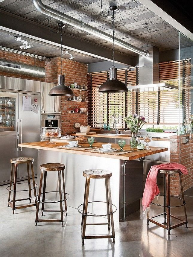 Bold, Unexpected, Mind-changing Industrial Studio Apartment Design. Civil looking neat kitchen with steel ventilation pipes at the ceiling