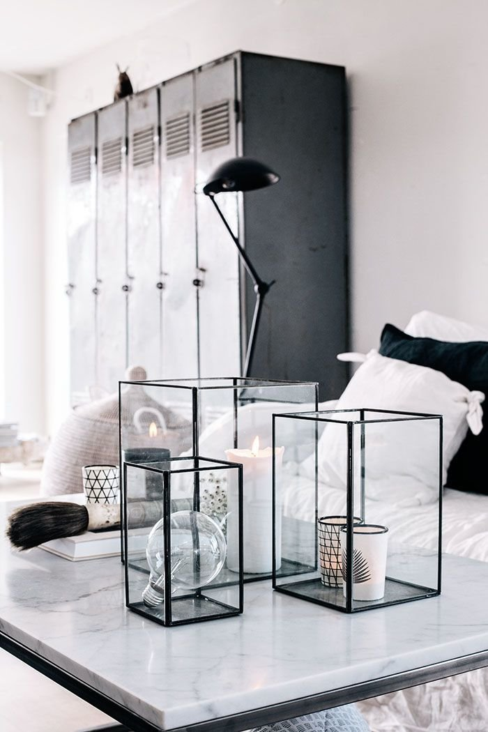 Bold, Unexpected, Mind-changing Industrial Studio Apartment Design. Black metal accessories for white room