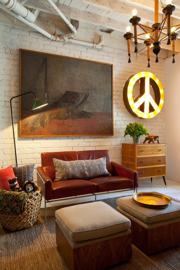 Peace sign at the wall and cozy vintage decorated room with colorful furniture