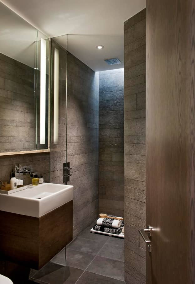 All about Using LED Lighting to Improve Your Shower Experience. Dark stone trimming of walls