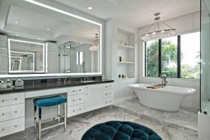 5 Enlightening Benefits of Hanging Lighted Mirrors on your Walls. Large boudoir right at the bathroom with large mirror and circular ottoman