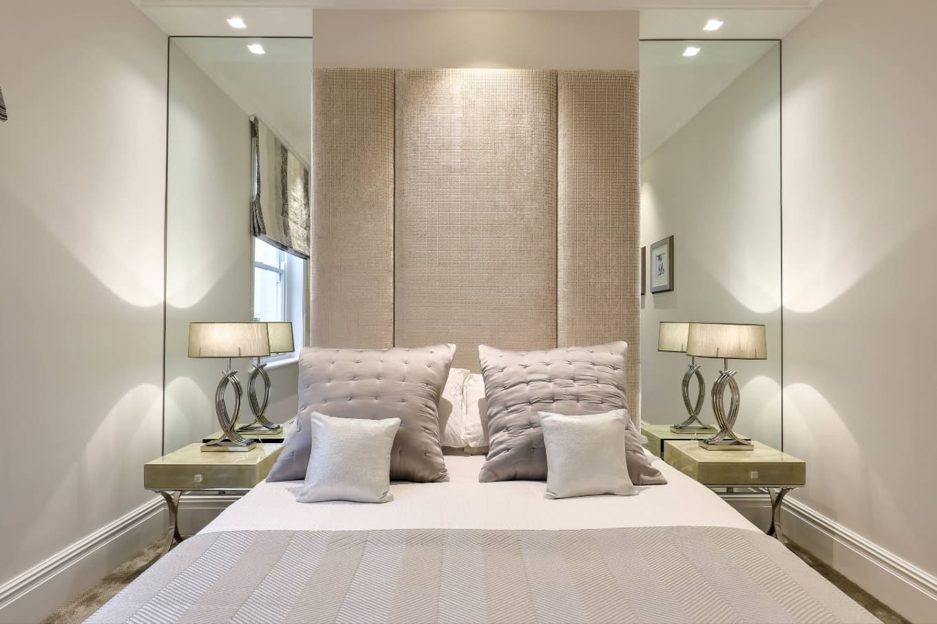 5 Enlightening Benefits of Hanging Lighted Mirrors on your Walls. Large wall-high mirror at the bedroom with soft headboard