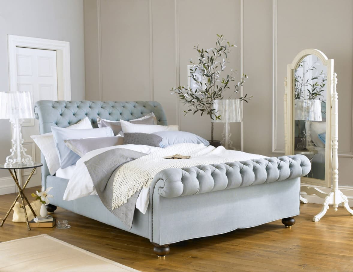 What are the Best Mattresses Suited for Lower Back Pain? Classic designed woman's bedroom in pale blue tones