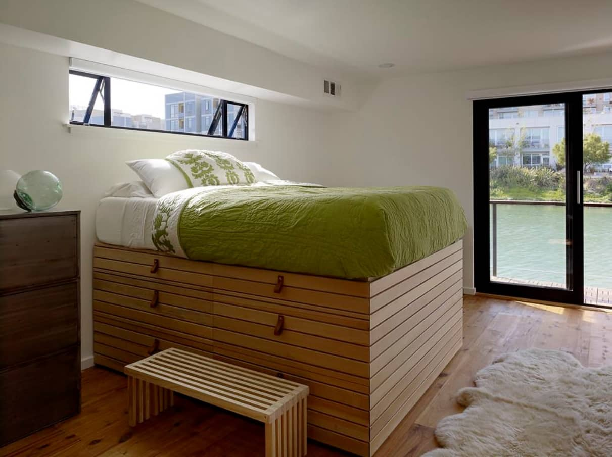 What are the Best Mattresses Suited for Lower Back Pain? Unusual but peculiar design of the bed with green bedding