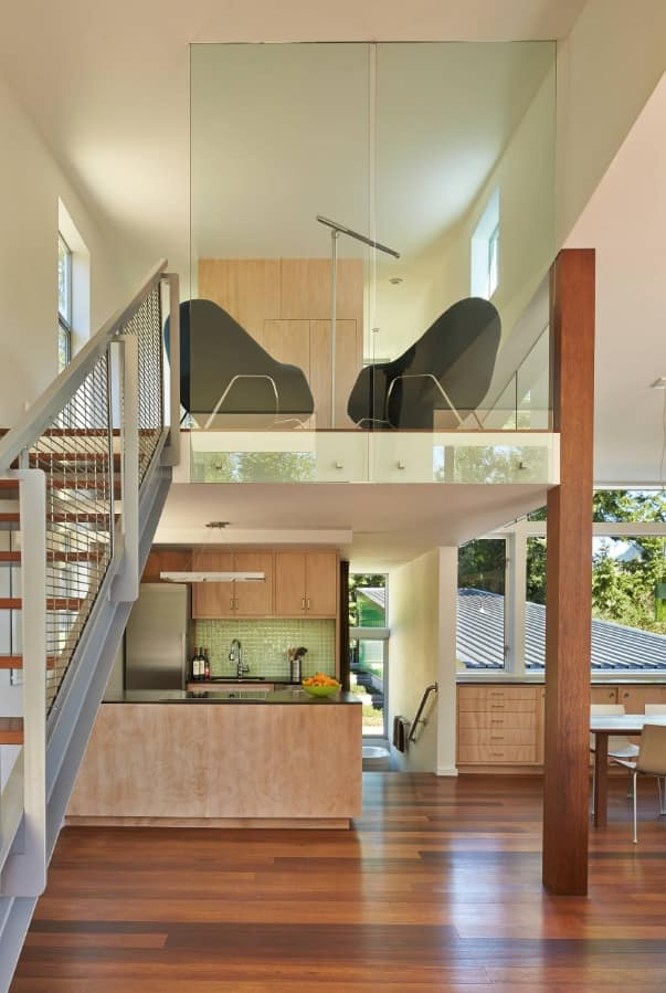 5 Tips to Bring Out the Minimalist Home Designer in You. Glass delimited second floor of the open space flat