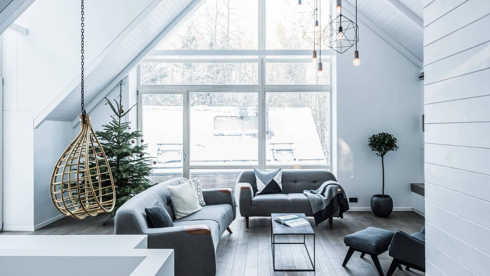 white Scandinavian interior for large cottage living room with loft sloped ceiling