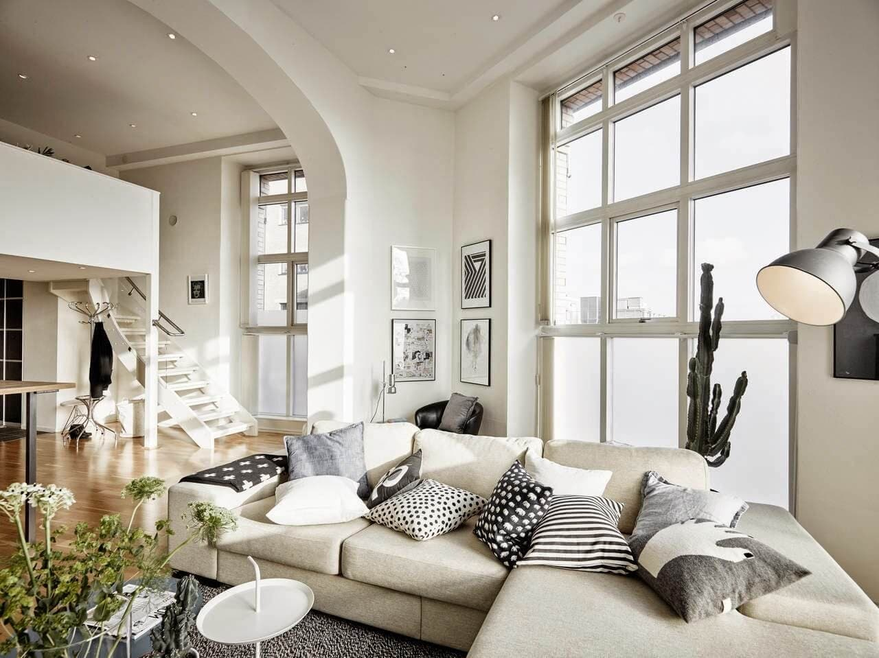 The Use of Monochromatic Interior Design to Create Stunning Interior. Large casual space with hige sash window