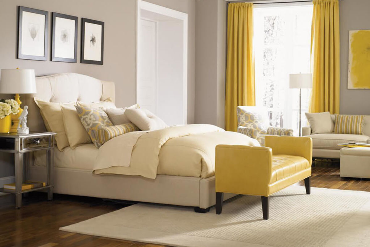 Pastel yellow/beige color tones for monochromatic design of the bedroom