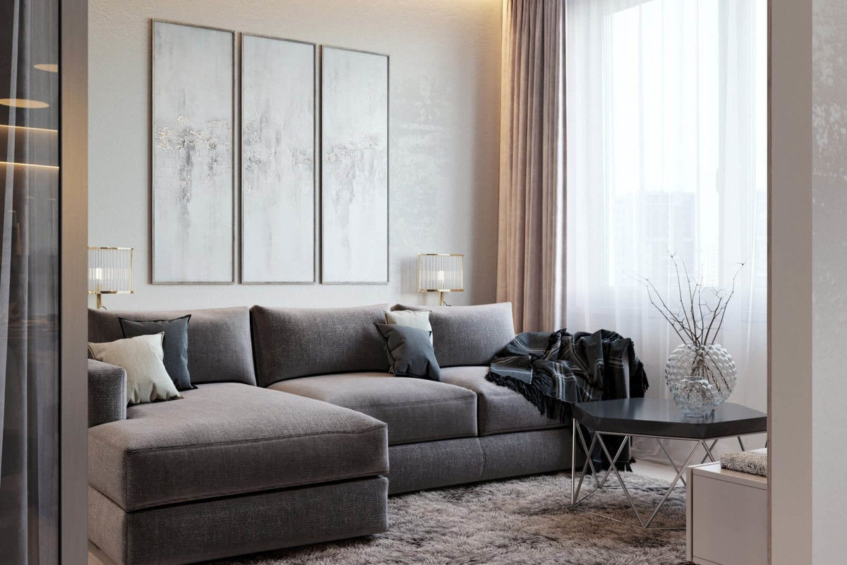 The Use of Monochromatic Interior Design to Create Stunning Interior. Gray sofa in pastel colored contemporary living room