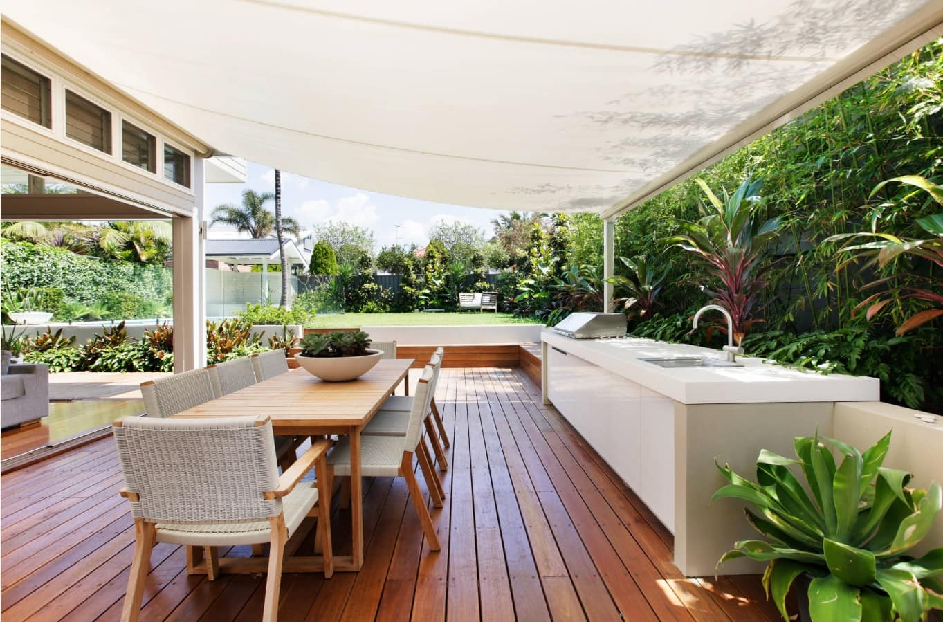 Retractable Patio Awnings Offer An Amazing Way to Upgrade Your Home. Large backyard deck patio with dining and barbecue zones