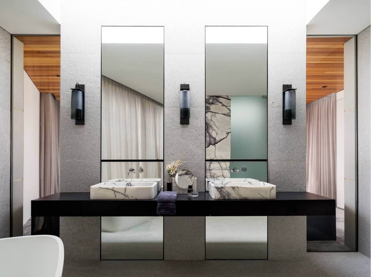 Why Do We Use Wall Sconces. Bathroom in ultramodern hi-tech style with large mirrors