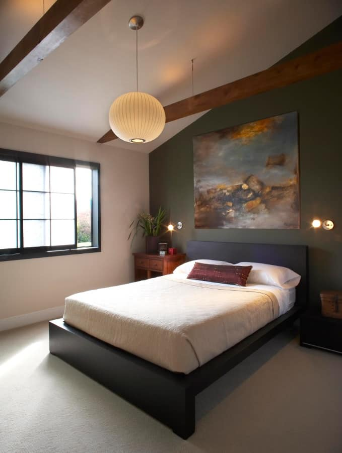 Why Do We Use Wall Sconces. Black accent wall of the zen bedroom with exposed ceiling beams and dark platform bed