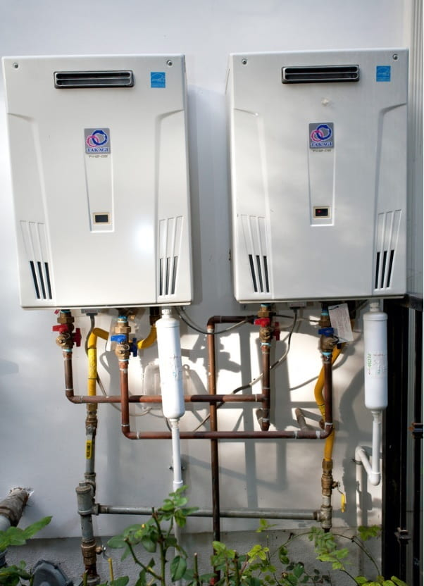 Fixing Home Appliances and Water Heater Maintenance. Double water heater outside the house