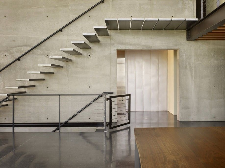 Industrial Style Interior Design Overview with Photos. Hi-tech touch of the house with airy concrete stairway