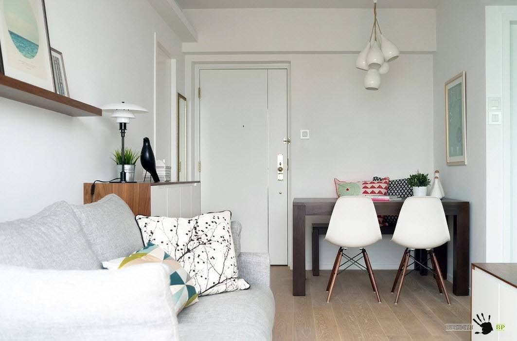 Simple designed tiny living at the open space condo in white