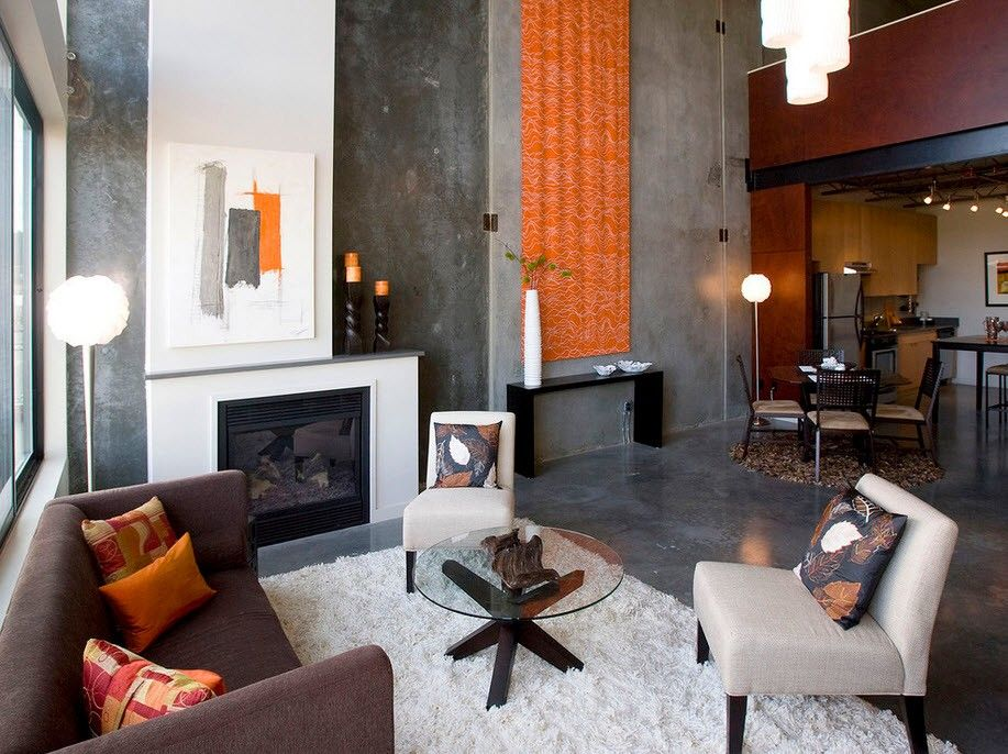 Orange accent for apparently industrial room with fluffy rug at the living zone