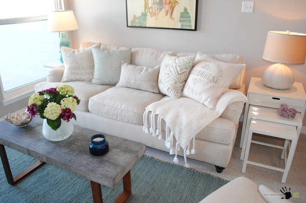 Living room with white couch and gray topped table