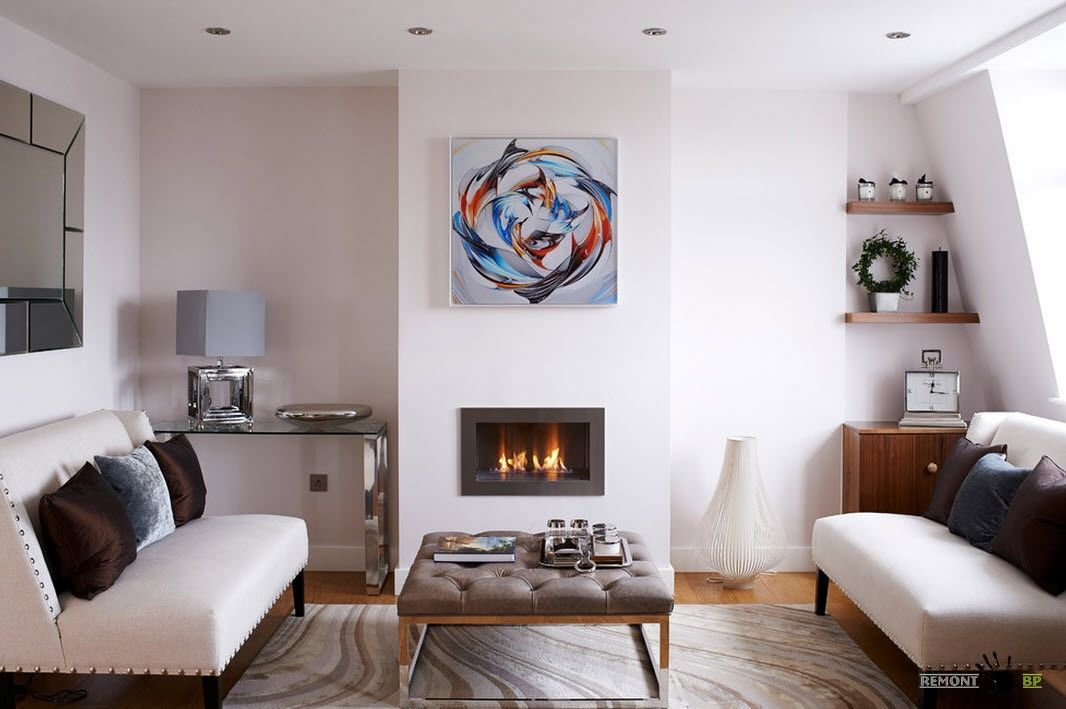 White Scandi styled living with the fireplace and the picture on accent wall