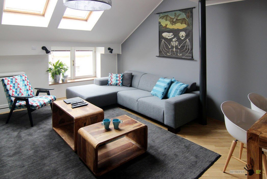 Gray wall painted attic living with wooden tables and angular sofa
