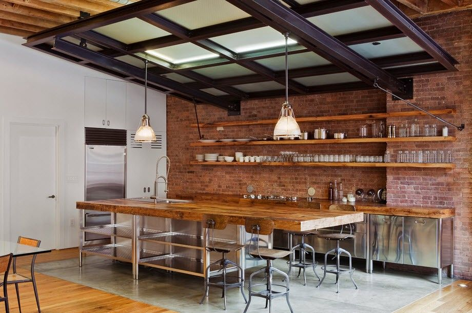 Black frame glass ceiling over the wooden trimmed industrial kitchen