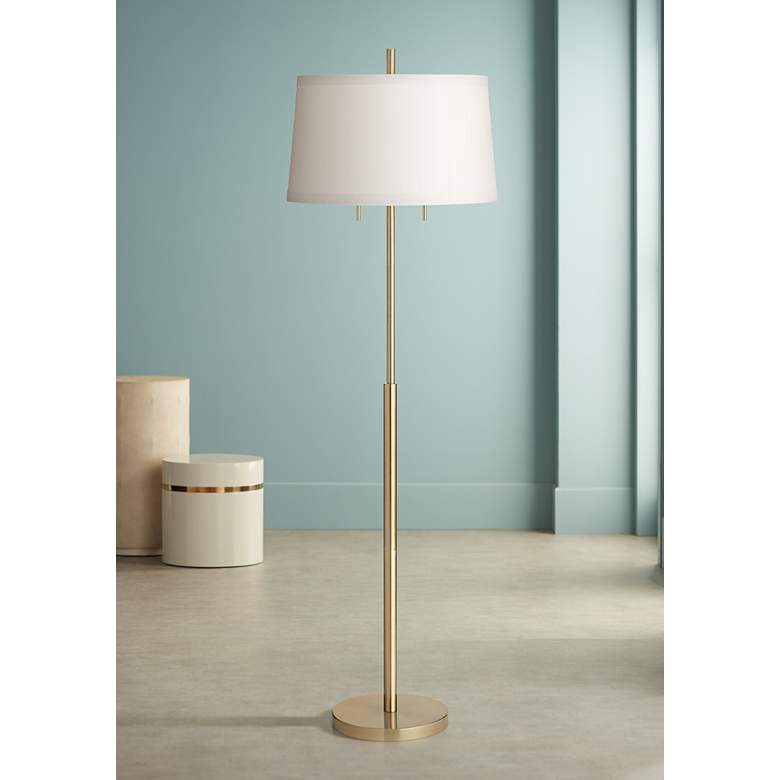Neat bluish interior decoration and the simple designed floor lamp on gold leg