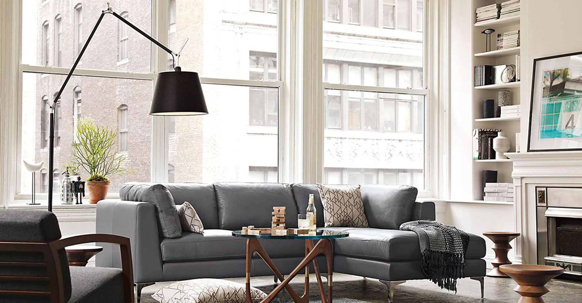 Stylish Lighting for Specific Zones: Floor Lamps Overview. Dark grey couch with cushions and black lampshade for casual apartment with large windows