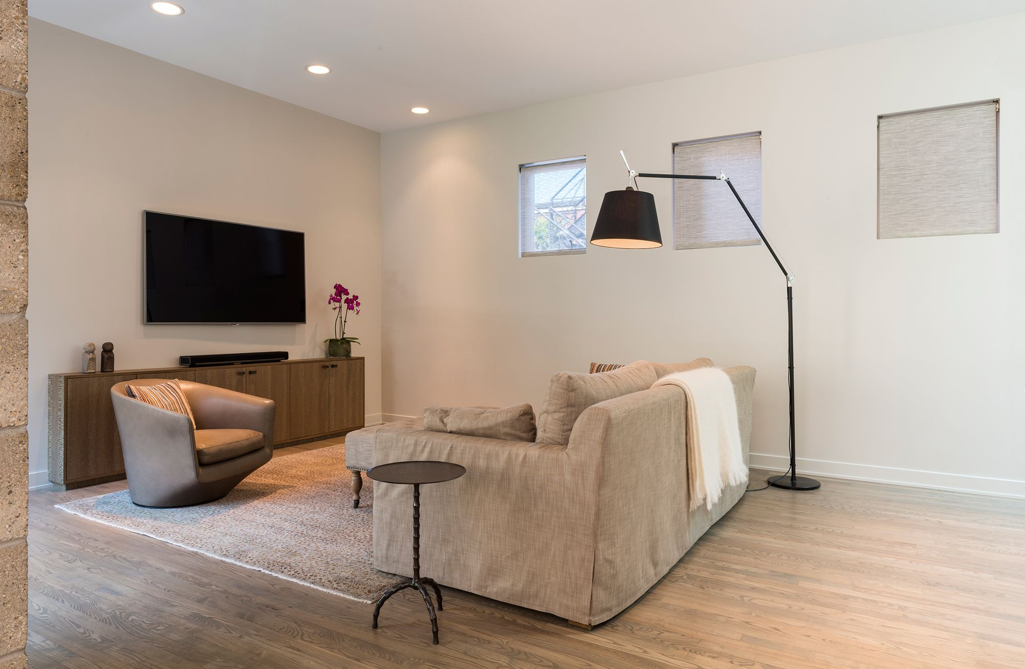 Stylish Lighting for Specific Zones: Floor Lamps Overview. Beige color palette for contemporary styled living room with fireplace and large LED TV