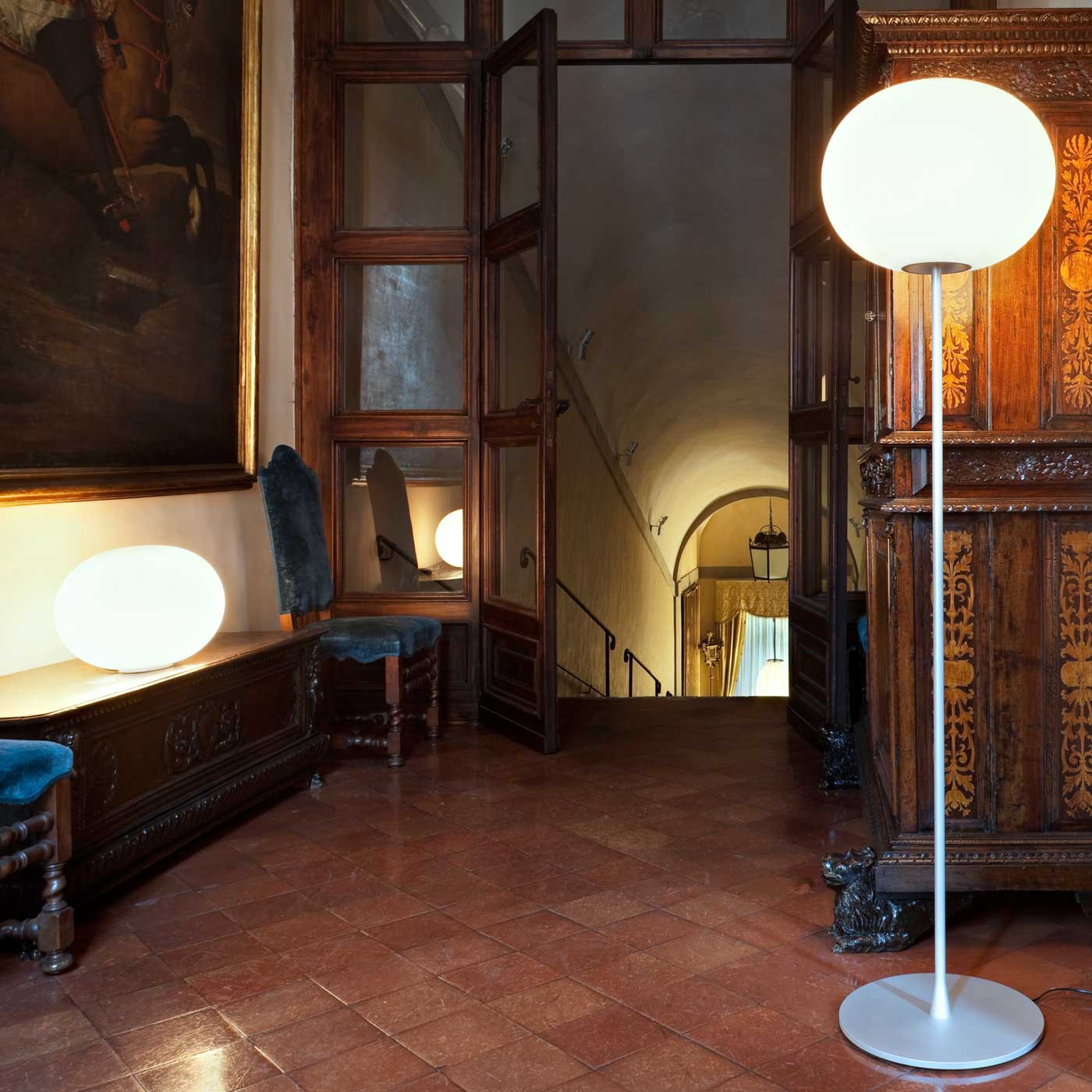 Stylish Lighting for Specific Zones: Floor Lamps Overview. Classic wooden trimmed interior in the 1920s style with parquet and carved table