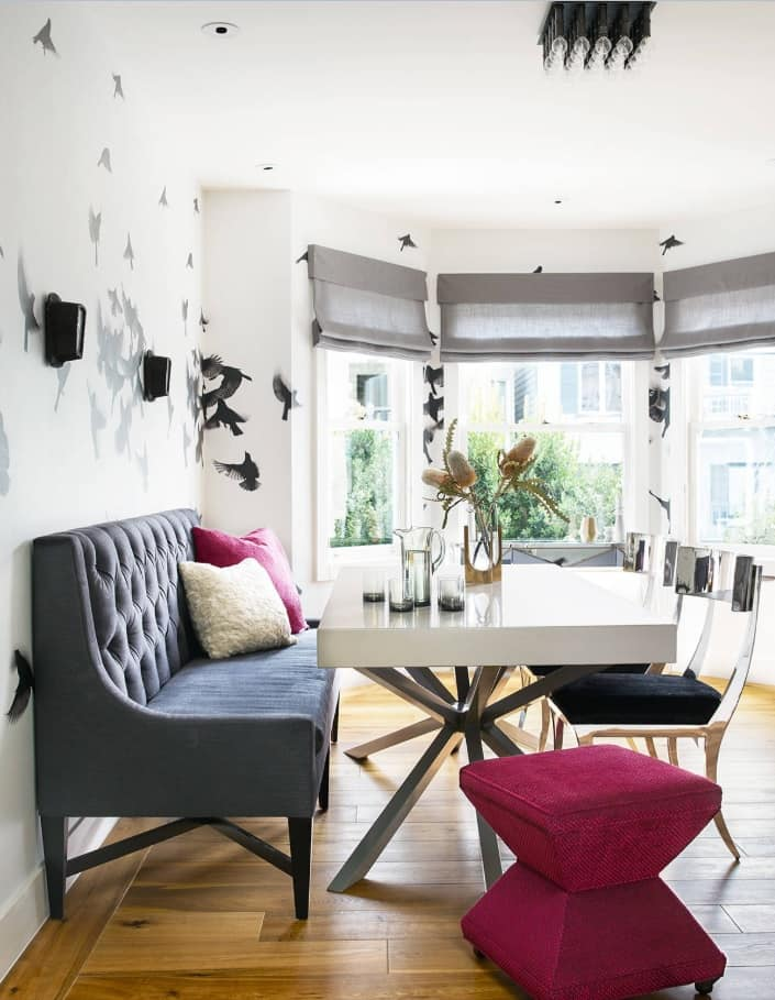 Bay window for the open layout apartment withgrey and white dining set and painted walls