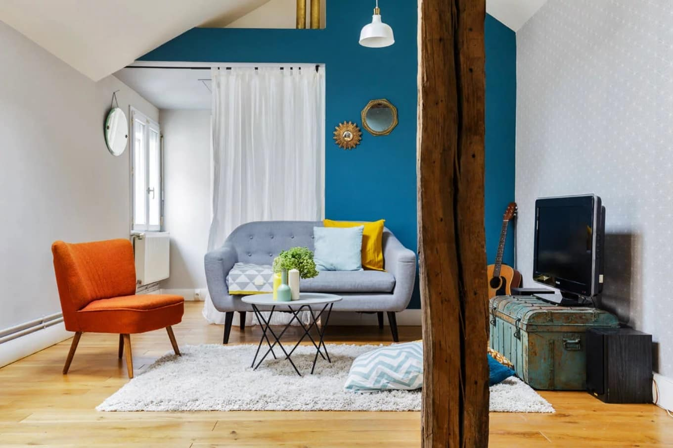 Things to Consider when Renovating A Home. Great color palette for the casual living room with blue painted walls and colorful furniture