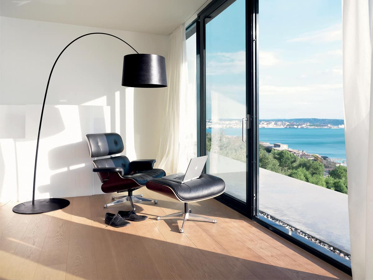Stylish Lighting for Specific Zones: Floor Lamps Overview. Contrasting black and white interior for the modern apartment with Eames chair and arched lamp