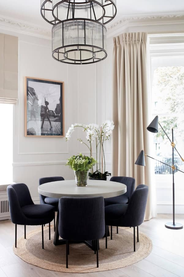 Gray Wood Round Dining Table to Complete the Breathtaking Dining Room. Dark dining group and plant decoration of the table