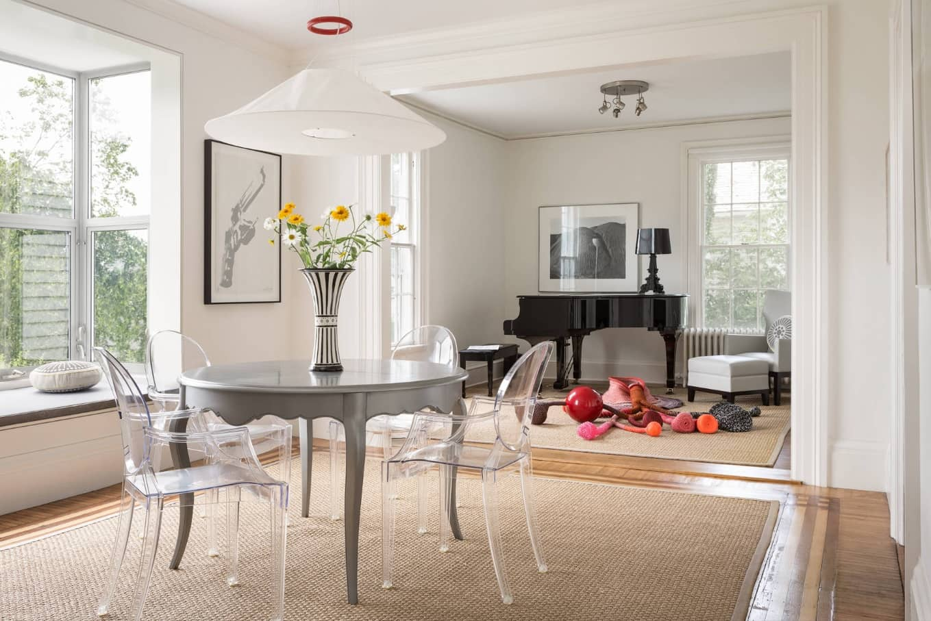 Gray Wood Round Dining Table to Complete the Breathtaking Dining Room. Classic interior with grand piano and large space scale