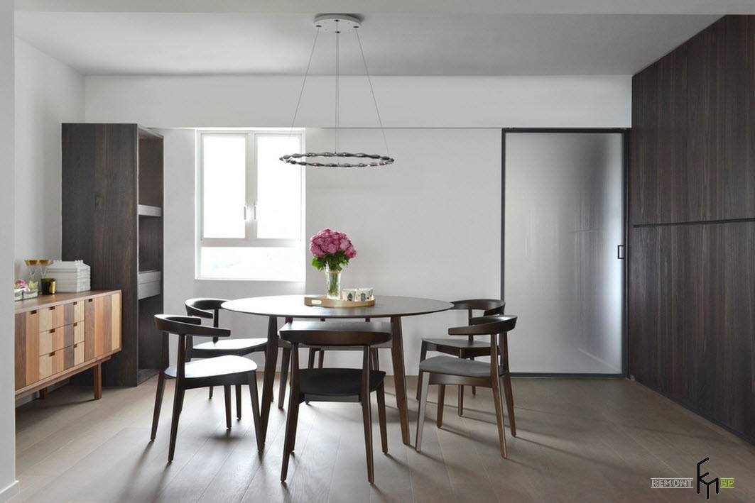 Gray Wood Round Dining Table to Complete the Breathtaking Dining Room. Ultramodern LED lamp over the minimalistic dining zone