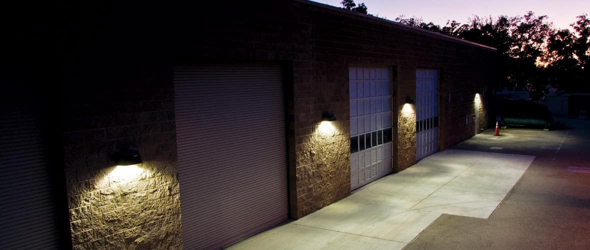 LED Wall Pack for your Home: Increase Ourdoor Lighting and Safety. Stone trimmed garage and warehouse with wall led lamps